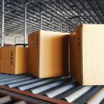 Boxes on a conveyor belt in a factory